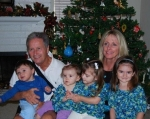 Denise Harris Henke and her husband Larry with their four grandchildren at Christmas in 2008.